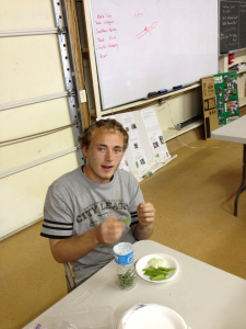 student holding snap peas